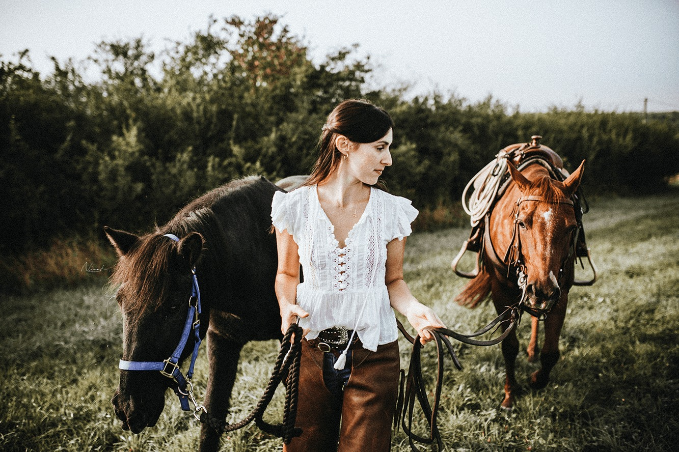 two horses - cowgirl - morning sun